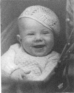 Darling Hope Baby looking jaunty in a knitted beret